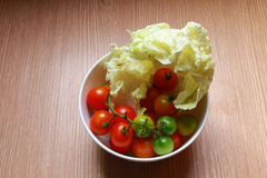 Tomato and chinese cabbage. The tomato and chinese cabbage are in the bolw prepare to serve Royalty Free Stock Photos