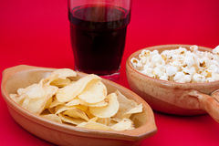 Tomato chips, pop corn and cola Royalty Free Stock Images