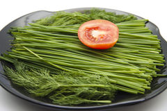 Tomato with chives Stock Photo