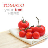 A tomato on chopping board Royalty Free Stock Photo