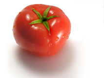 Tomato close-up. A fresh tomato on white background Royalty Free Stock Photo