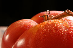 Tomato close-up. Macro shot of large heirloom tomato from the garden Royalty Free Stock Photo