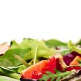 Tomato Closeup in Salad. Closeup of tomato slice in a salad bowl Stock Image