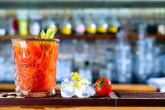 Tomato cocktail on the bar counter. Selective focus royalty free stock image
