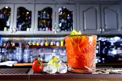 Tomato cocktail on the bar counter,. Selective focus royalty free stock photos
