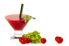 Tomato Cocktail Made With Fresh Ingredients Isolated on white. Tomato cocktail served in a conical martini glass made with fresh ingredients with whole cherry stock images