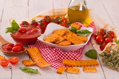 Tomato crackers. Tomato crackers with rosemary on white dish stock photo