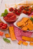 Tomato crackers. Tomato crackers with rosemary on white dish stock photos
