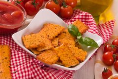 Tomato crackers. Tomato crackers with rosemary on white dish stock image