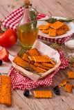 Tomato crackers. Tomato crackers with rosemary on white dish royalty free stock image