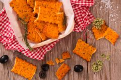 Tomato crackers. Tomato crackers with rosemary on white dish royalty free stock photography