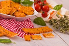 Tomato crackers. Tomato crackers with rosemary on white dish royalty free stock photo