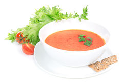 Tomato cream soup garnished with salad leaves Royalty Free Stock Photos