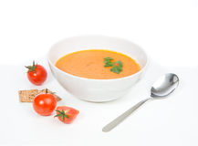 Tomato cream soup garnished with salad Stock Photo