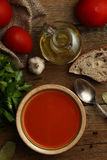 Tomato cream soup with ingredients on wooden background. Top vie Stock Photos