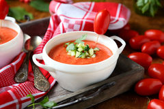 Tomato cream soup in a white tureen Stock Image