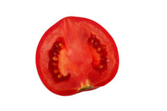 Tomato Cross Section. Fresh juicy tomato cross section. Isolated on the white backgraund Royalty Free Stock Photography