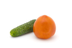 Tomato and cucumber. On the white background Royalty Free Stock Photo