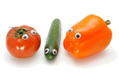 Tomato, cucumber and bellpepper with eyes Royalty Free Stock Photography