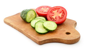 Tomato and cucumber on the board. Stock Images