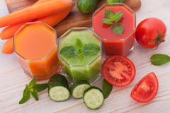 Tomato, cucumber, carrot Juice and vegetables Royalty Free Stock Image