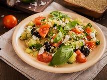 Tomato cucumber feta olive quinoa salad Royalty Free Stock Images