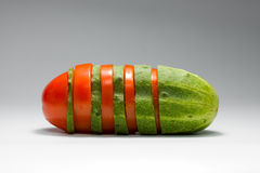 Tomato and cucumber intersection. Composition of sliced tomato and cucumber Royalty Free Stock Images