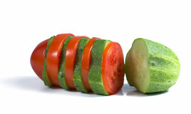 Tomato and cucumber intersection. Composition of sliced tomato and cucumber Stock Photography
