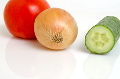Tomato, cucumber and onion for salad. Tomato, cucumber and onion for preparation of salads royalty free stock photos