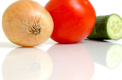 Tomato, cucumber and onion for salad. Tomato, cucumber and onion for preparation of salads stock images