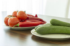 Tomato, cucumber, pepper on plate Stock Image