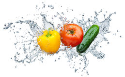 Tomato, cucumber, pepper in spray of water Stock Images