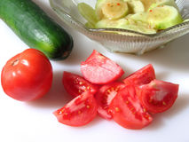 Tomato and Cucumber Salad. Preparing a tomato and cucumber salad royalty free stock images
