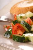 Tomato cucumber salad with vinaigrette and bread Stock Photos