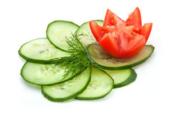 Tomato and cucumber slices. Slices of cucumber and a sprig of fresh dill, red tomatoes Royalty Free Stock Images