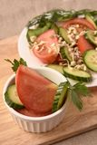 Tomato and cucumber. White plate. Sprouted beans. Fresh salad. Healthy food royalty free stock images