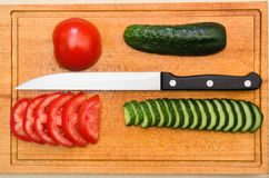 Tomato and cucumbers board Royalty Free Stock Image