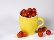 Tomato cup. Cup with tomato isolated on white Royalty Free Stock Photos