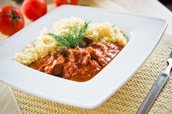 Tomato curry with couscous Stock Images