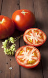 Tomato cut in half with oregano twig Stock Photos