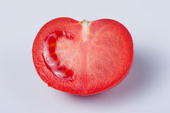 Tomato. Cut in half on white background Stock Images