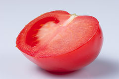 Tomato. Cut in half on white background Royalty Free Stock Photo
