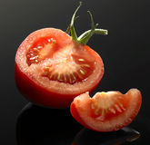 Tomato and cut Royalty Free Stock Photo