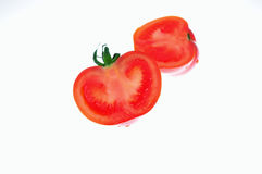 Tomato cut into two isolated white Royalty Free Stock Photography