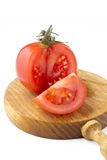 Tomato cut on wood Royalty Free Stock Images