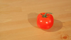 A tomato on a cutting board stock video
