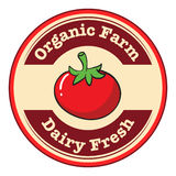 A tomato with a dairy fresh and organic farm label Stock Images