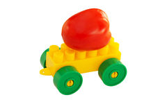 Tomato on the details of children's designer. With wheels Royalty Free Stock Photo