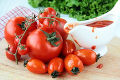 Tomato of different varieties and sauce Stock Image