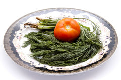 Tomato with dill on plate. And on white background Royalty Free Stock Images
